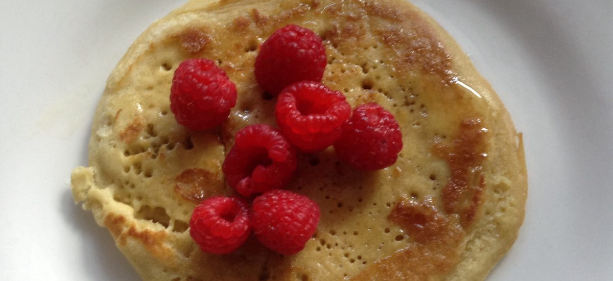 Gluten-free millet pancakes with raspberries