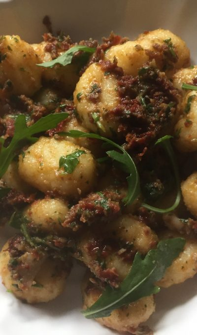 Potatoes gnocchi with olives, sundried tomatoes & rocket pesto