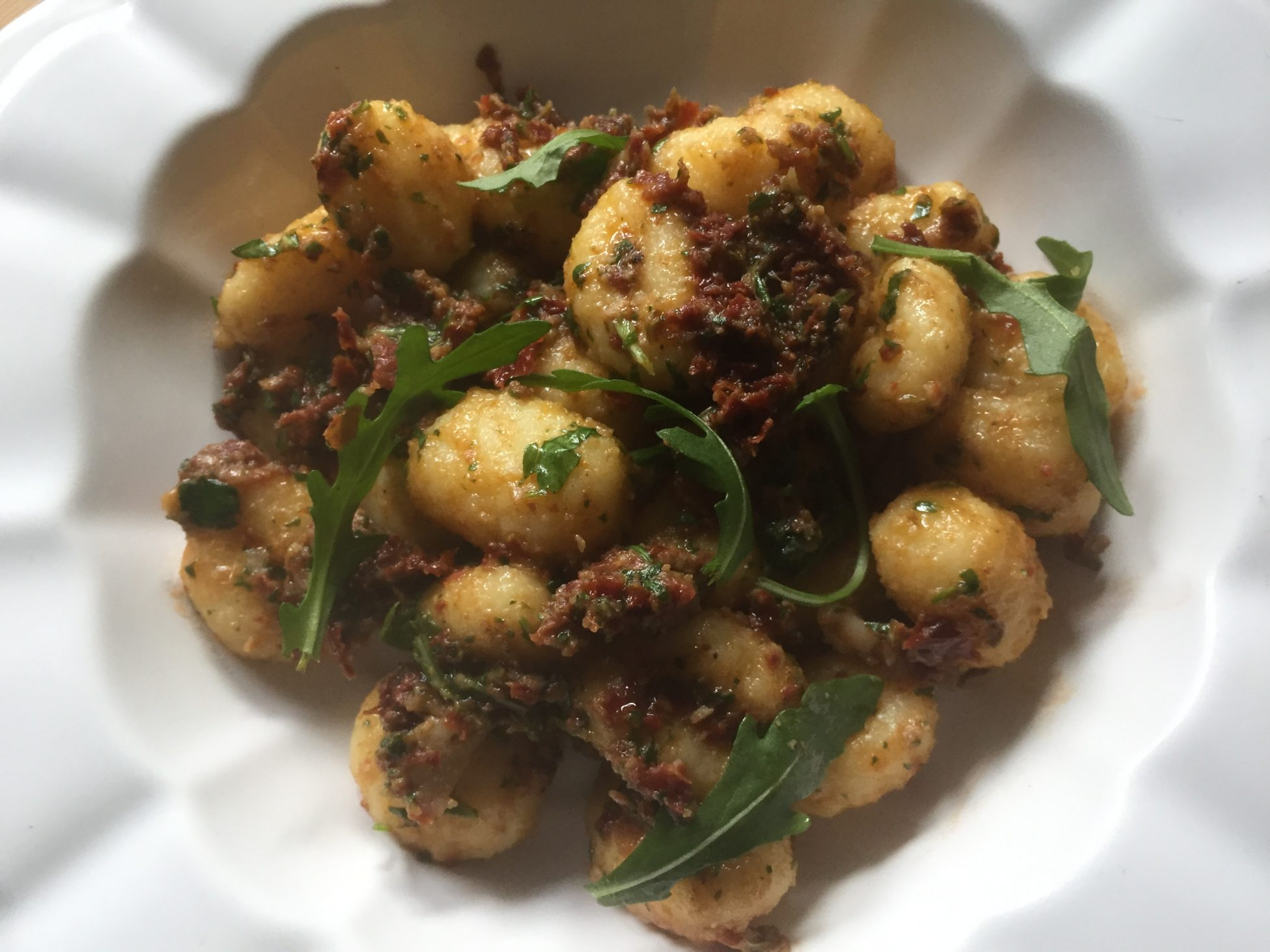 Potatoes gnocchi with olives, sundried tomatoes & rocket pesto