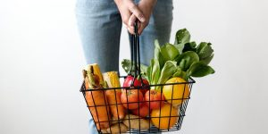 woman healthy foods fruits vegetables basket
